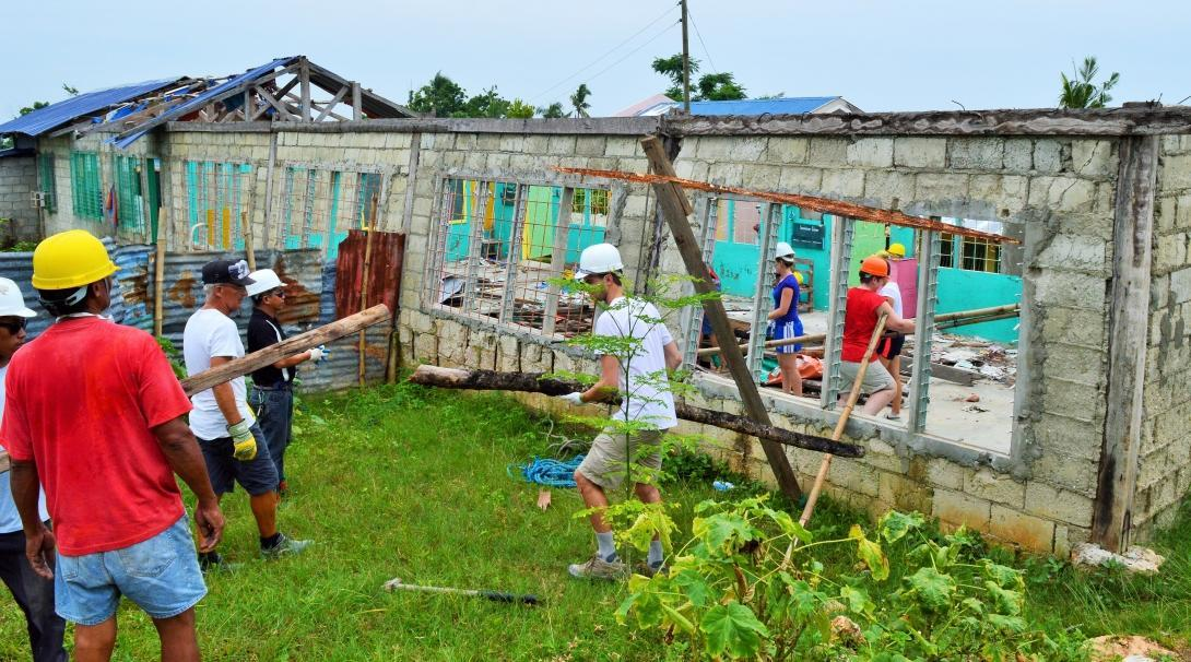 Volunteers secure a structure as part of disaster relief during their building volunteer work in the Phillippines.